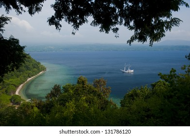Satonda Island, Indonesia.  Satonda is a small uninhabited volcanic Island off the northern coast of Sumbawa.  The center of the island holds a mysterious salt water lake with clear water.