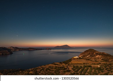 Satrry skys of Greek islands, night landscape of calm Mediterranean sea, romantic place for summer vacation