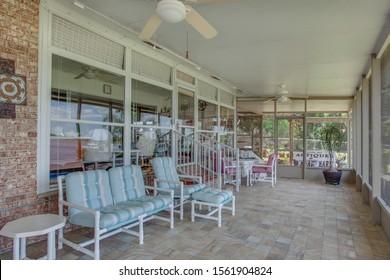 Satsuma, Florida / USA - November 16 2019: Screened in back porch with comfortable chairs