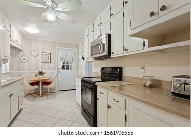 Satsuma, Florida / USA - November 16 2019: Kitchen with white cabinets and eat in area