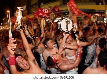 SATSUMA SENDAI, JAPAN - SEPTEMBER 22: Men celebrate after winning the Sendai tug-of-war (tsunahiki)  September 22, 2009 in Satsume Sendai City, Japan .