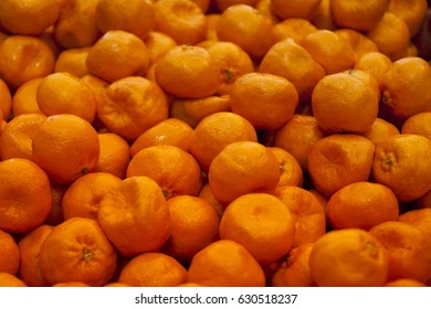 Satsumas on a market stall in Harbour Town, Queensland, Australia. Full-frame, Background, Healthy Food