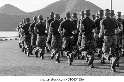 SATTAHIP CHONBURI - AUGUST , 27 : A group of Royal Thai Naval Cadets  run together in row along the beach road at Marine corp department . THAILAND AUGUST,27 2015