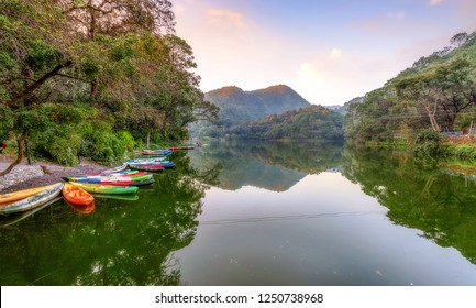 Sattal lake at sunset with scenic landscape and view of tourist boats at Nainital Uttarakhand India.