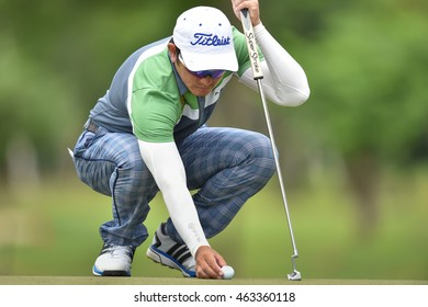 Sattaya Supupramai of Thailand lines for a putt during round one of the King's Cup at Phoenix Gold Golf and Country Club on July 28, 2016 in Pattaya, Thailand.