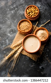 Sattu sharbat is a cooling sweet drink made in summer with roasted black chickpea flour, barley, suger, salt & water. served in a glass. selective focus