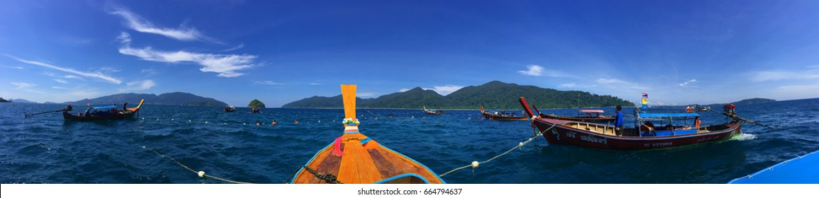 Satun, Koh Lipe, Tarutao National Park, Thailand - February 08, 2017:Panorama, Longtail boat stay in the middle of the sea. The tourist diving to see coral and fish. enjoy.