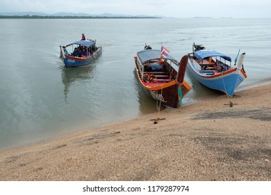 Satun, Thailand - 1 September, 2018 : Tourists from Malaysia on wooden boat service at Dragon Spine beach in Satun. Satun is a southern province of Thailand.