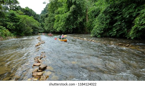 SATUN, THAILAND 7 SEPT, 2018 - Tourists from Malaysia participate in river activities such as kayaking at Wang Sai Tong river. Satun is southern province of Thailand popular with halal tourism.
