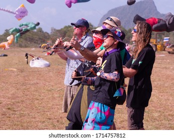 Satun, Thailand - February 22, 2020: Five participants flying their quad line kites at the 40th Satun International Kite Festival in Thailand.