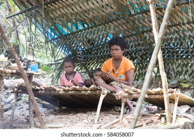Satun, Thailand - Febuary 12, 2015: Sakai Family (Jungle Tribes, The Negrito of Thailand) live in their hut made from wood and leaves. They hunt animals and consume vegetables and fruits.