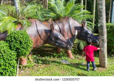 Satun, Thailand - May 19, 2018: Rhino Statue at entrance of Tham Le Stegodon Cave in Satun, Thailand.