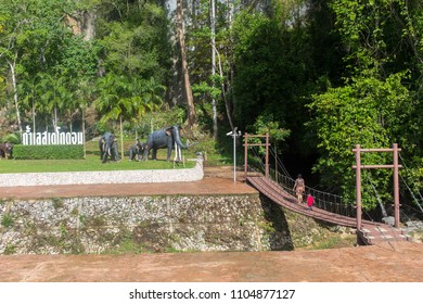 Satun, Thailand - May 19, 2018: The bridge and entrance of Tham Le Stegodon Cave in Satun, Thailand.