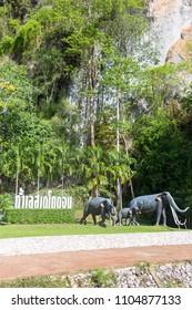 Satun, Thailand - May 19, 2018: Stegodon Elephant Statue at entrance of Tham Le Stegodon Cave in Satun, Thailand.