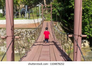 Satun, Thailand - May 19, 2018: The bridge at entrance of Tham Le Stegodon Cave in Satun, Thailand.