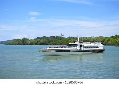 SATUN, THAILAND - MAY 19, 2018 : Lipe ferry and speed boat group ferry boat heading out to lipe island at Pakbara pier to Lipe island in Satun province, thailand