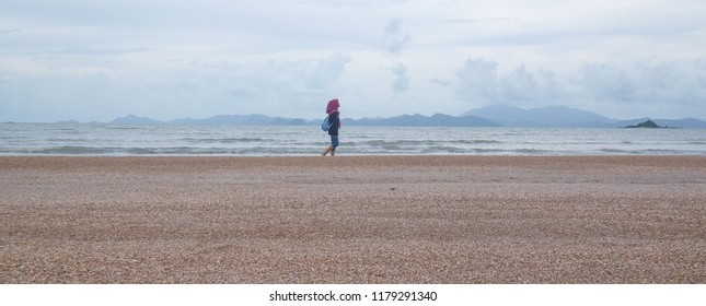 Satun, Thailand - September 7, 2018 : Tourists at Dragon Spine Beach in Satun province. The 5 kilometers spine beach emerges after big tsunami in 2004.