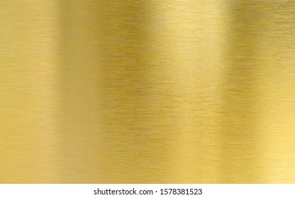 Saturated golden metal brushed texture plate