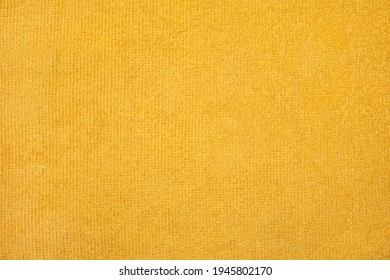 Saturated smooth yellow cleaning rag. Microfiber cloth