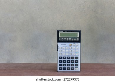 Saturday, 25 April 2015: in Chiangmai Thailand ,Casio calculator on wood table and vintage background