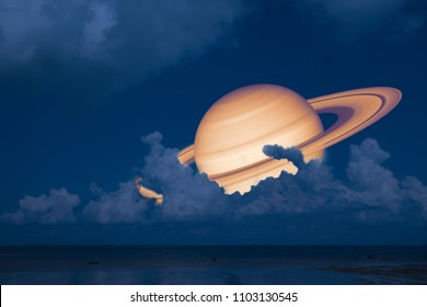 Saturn back night cloud sunset sky on sea. concept Saturn near Earth, Elements of this image furnished by NASA