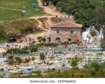 SATURNIA, TUSCANY, ITALY - JUNE 15, 2019: View of Saturnia thermal spa, Cascate del mulino ie Mill Waterfalls area. Beautiful natural formations.