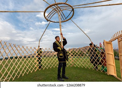 SATY VILLAGE, KAZAKHSTAN - AUGUST 29, 2017: Kazakh men build nomadic tent known as yurt, in Saty Village, Kazakhstan.