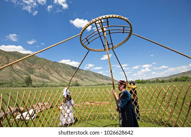 SATY VILLAGE, KAZAKHSTAN - JUNE 3, 2017: Kazakh people build a yurt and hold the crown of the dome, in Saty Village, Kazakhstan.