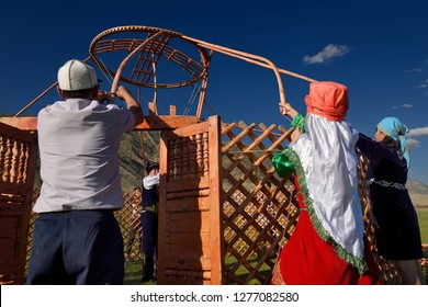 Saty villagers putting up a Yurt in Chilik river valley Saty, Kazakhstan - September 7, 2016