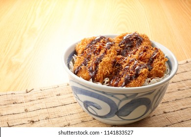 Sauce Katsu Don (deep fried pork cutlet dipped in Worcestershire sauce on rice)
