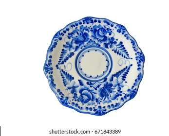 The saucer on a white background. Saucer in Russian traditional Gzhel style. Closeup. Isolated on white. Gzhel - Russian folk craft of ceramics and production porcelain and a kind of Russian folk pain