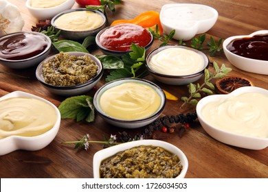 Sauces Assortment. Set of various sauces in bowls with ketchup, mayonnaise, pesto and mustard