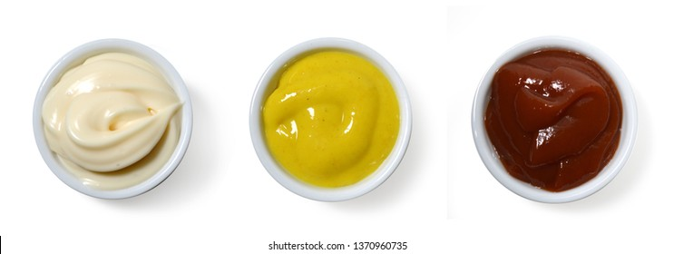 Sauces. Mayonnaise, Catchup and mustard in small porcelain containers viewed from above.