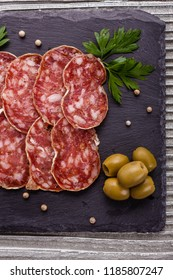Saucisson sec delicious french salami on a wooden background