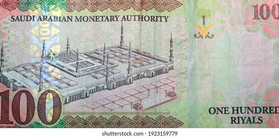 Saudi Arabia 100 riyals banknote, The Saudi riyal is the currency of Saudi Arabia, selective focus of Saudi kingdom one hundred riyals cash money.