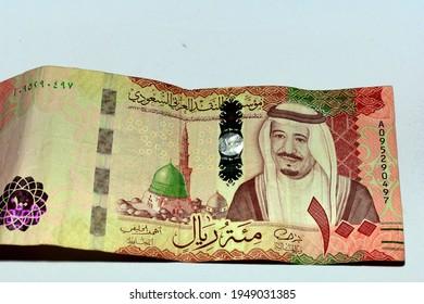 Saudi Arabia 100 riyals banknote, The Saudi riyal is the currency of Saudi Arabia, Saudi kingdom one hundred riyals  with the photo of king Salman Bin Abdulaziz and Madinah mosque (observe side)