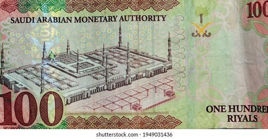 Saudi Arabia 100 riyals banknote, The Saudi riyal is the currency of Saudi Arabia, Saudi kingdom one hundred riyals  with the photo of king Salman Bin Abdulaziz and Madinah mosque (reverse side)