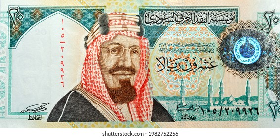 Saudi Arabia 20 riyals banknote, The Saudi riyal is the currency of Saudi Arabia, selective focus of Saudi kingdom twenty riyals cash with the photo of king Abdul Aziz ,   Quba Mosque, light mountain
