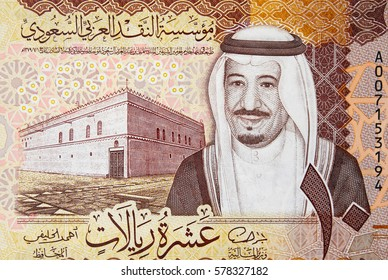 Saudi Arabia 5 riyal (2016) banknote fragment, King Salman and Palace of late King Abdulaziz in Almoraba Area, Saudi Arabian money close up.