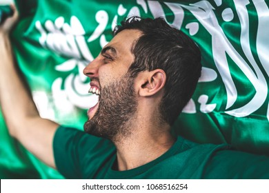 Saudi Arabia fan celebrating with flag