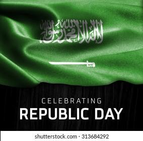 Saudi Arabia flag and Celebrating Republic Day Typography on wood background