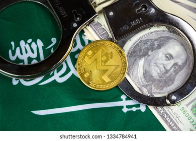 Saudi Arabia flag with handcuffs and a bundle of dollars and monero coin. Currency corruption in the country. Financial crimes