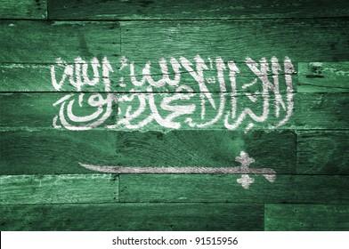 Saudi Arabia flag painted on old wood background