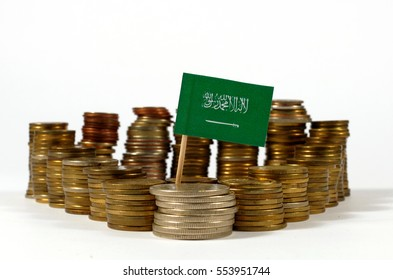 Saudi Arabia flag waving with stack of money coins