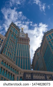 Saudi Arabia - July 2019 : Mecca Clock tower buildings written on it Arabic words (donations of king Abdul Aziz for two holy grounds mecca and medina) with beautiful sky view beside Mecca Holy Mosque