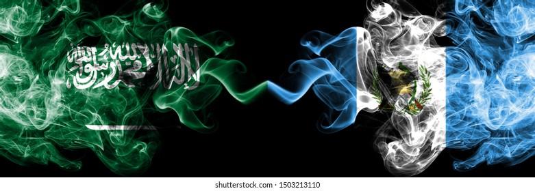 Saudi Arabia Kingdom vs Guatemala, Guatemalan smoky mystic flags placed side by side. Thick colored silky smoke flags of Arabic, Arabian and Guatemala, Guatemalan