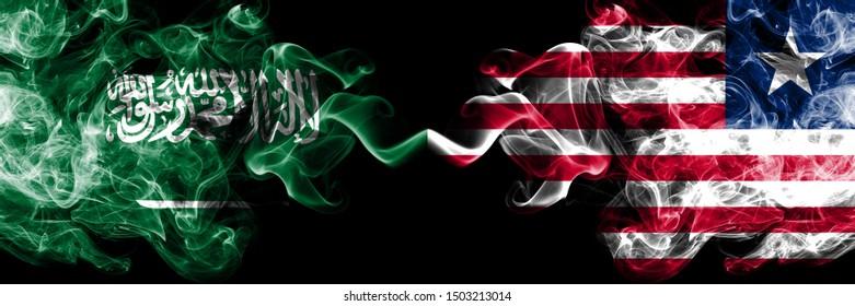Saudi Arabia Kingdom vs Liberia, Liberian smoky mystic flags placed side by side. Thick colored silky smoke flags of Arabic, Arabian and Liberia, Liberian