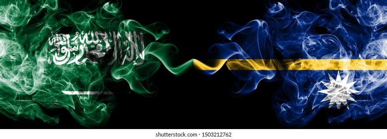 Saudi Arabia Kingdom vs Nauru smoky mystic flags placed side by side. Thick colored silky smoke flags of Arabic, Arabian and Nauru
