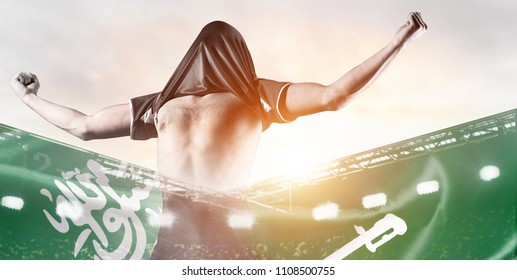 Saudi Arabia national team. Double exposure photo of stadium and soccer or football player celebrating goal with his jersey on head