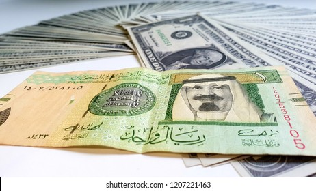 Saudi Arabia Riyal & One US Dollar -  Saudi Riyal Banknote has a Green Dome of The Prophet's Mosque in Medina And the Picture of  King Salman / The Prophet's Mosque in Al Madinah Al Monawarah
